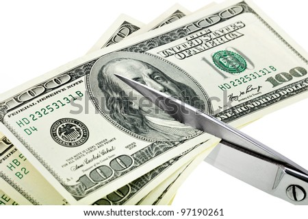Business concept. Dollars are cutting with scissors on a white background. - stock photo