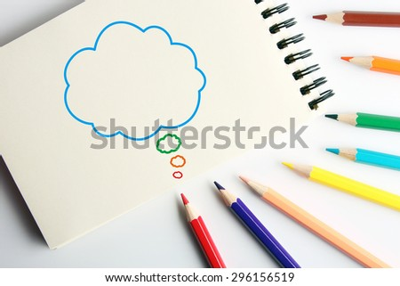Business concept drawing on the paper with color pencils aside. - stock photo