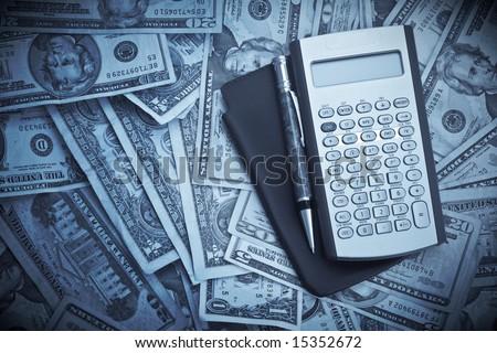 Business Concept Financial Calculator Pen Dollar - stock photo