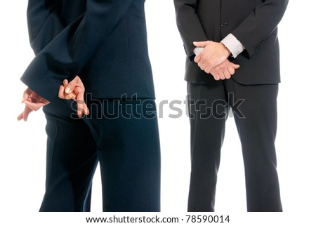 Business concept fingers crossed in front of boss isolated on white background