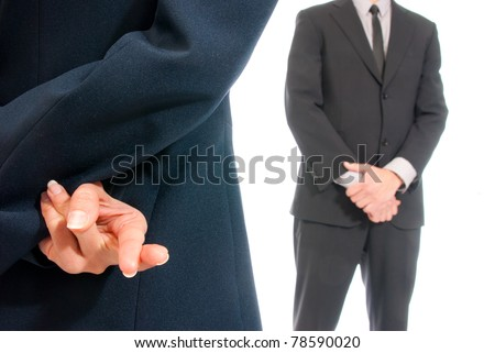 Business concept fingers crossed in front of boss isolated on white background - stock photo