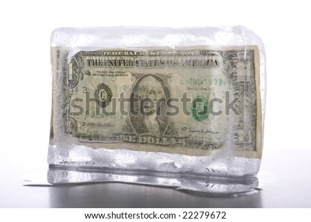Business concept for frozen assets - One US dollar note in ice - stock photo