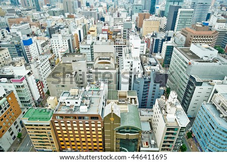 Business concept for real estate and corporate construction - panoramic modern city skyline bird eye aerial view under dramatic cloud and morning bright blue sky on Nagoya TV Tower in Nagoya, Japan
