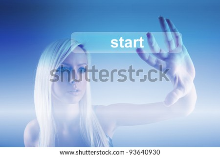 Business concept - girl with screen and start button - stock photo