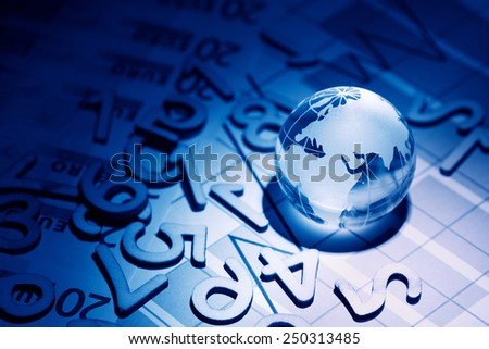 Business concept. Glass globe on background with diagram and numbers - stock photo