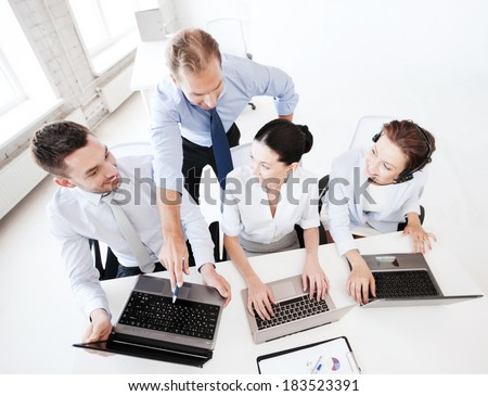 business concept - group of people working in call center or office - stock photo