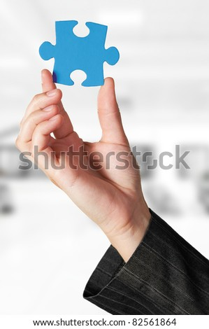 Business concept: Hand holding the missing jigsaw puzzle - stock photo