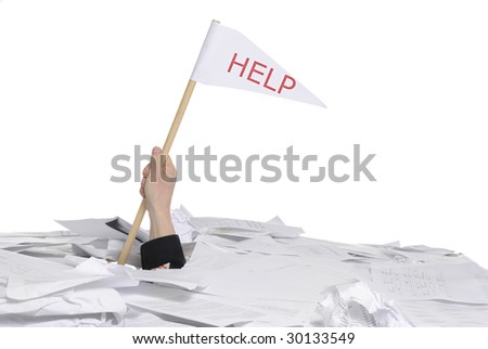 business concept: hand sticking out of desk full of papers with help flag - stock photo