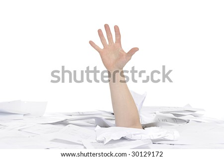business concept: hand sticking out of papers on a desk - stock photo