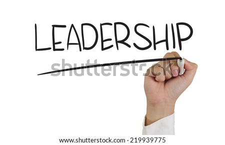 Business concept image of a hand holding marker and write Leadership word isolated on white - stock photo