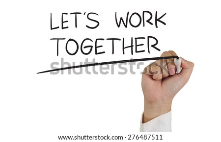 Business concept image of a hand holding marker and write Lets Work Together isolated on white