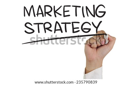 Business concept image of a hand holding marker and write Marketing Strategy words isolated on white