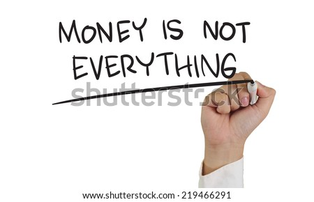 Business concept image of a hand holding marker and write money is not everything isolated on white