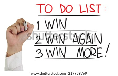 Business concept image of a hand holding marker and write To Do List : Winning isolated on white - stock photo
