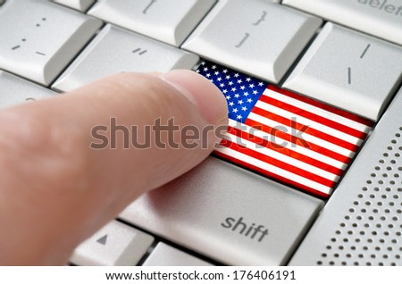 Business concept male finger pressing American enter key on metallic keyboard - stock photo