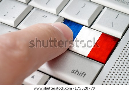 Business concept male finger pressing France enter key on metallic keyboard - stock photo