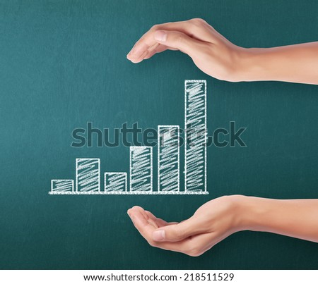 Business concept,  man with financial symbols coming from hand  - stock photo