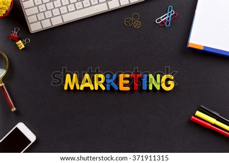 Business Concept: MARKETING single word on desk
