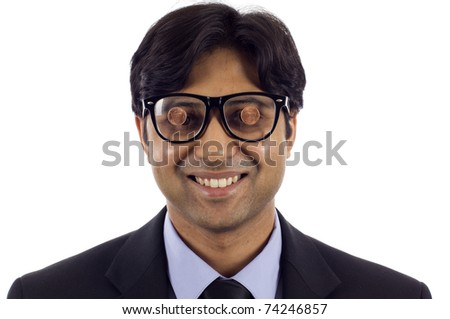 Business Concept: My 2 cents - My View  Smiling Indian business man wearing a black glasses with two cents on it, a lot of copyspace, isolated over white.