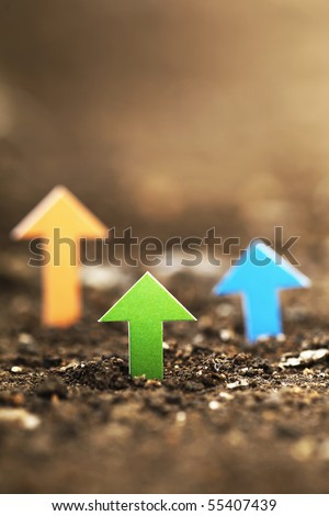 Business concept of Arrows sign on soil - stock photo
