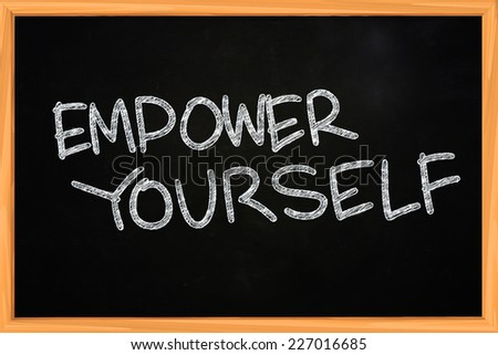 Business concept of Empower Yourself written with chalk on blackboard - stock photo