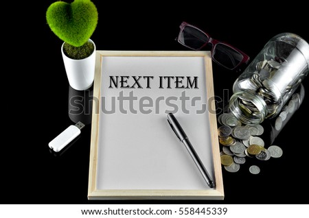Business concept - Office table with equipment and text written Next Item