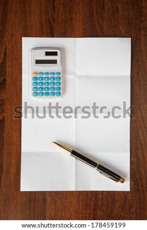 Business concept  paper with calculator and pen - stock photo
