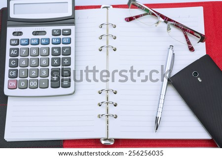 Business concept.Pen,notebook,calculator and glasses - stock photo