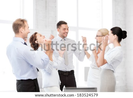 business concept - picture of happy business team celebrating victory in office - stock photo