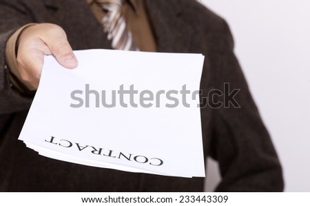 Business concept signing contract. Businessman giving blank empty paper sheet with sign contract and space for text.