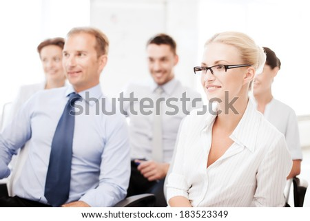 business concept - smiling businessmen and businesswomen on conference - stock photo