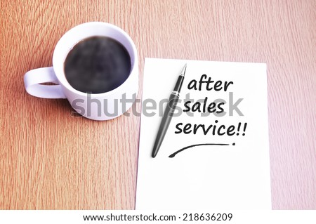 Business Concept - Steamy Coffee And Black Pen With White Paper Writing After Sales Service On The Table