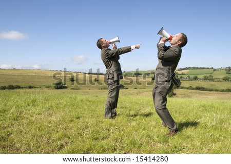 Business concept. two businessmen, two megaphones. Loud and clear! - stock photo