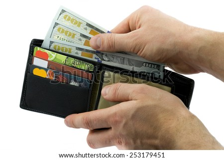 Business concept. Wallet with credit cards and dollars in man hands isolated on white background - stock photo