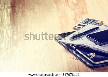 Business concept with agenda, smartphone and calculator. Copy space - stock photo