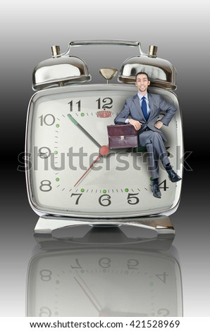 Business concept with businessman and clock - stock photo
