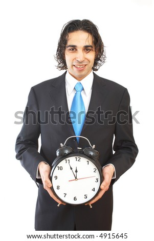 business concept with businessman holding an alarm clock - stock photo