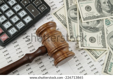 Business concept with calculator, judge gavel, money and documents  - stock photo