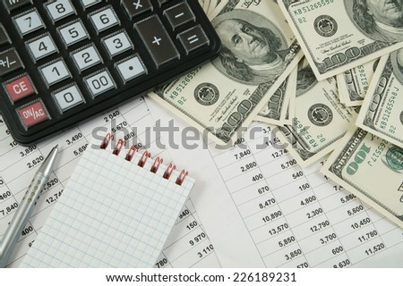 Business concept with calculator, notebook, money and documents  - stock photo