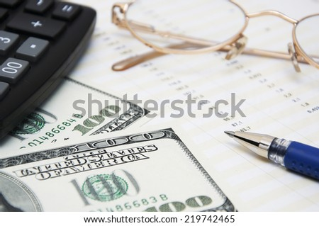 Business concept with documents and usa dollars