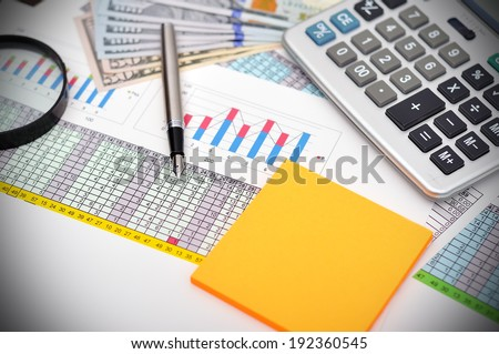 Business concept with documents, calculator