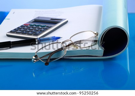 Business concept with notebook and calculator - stock photo