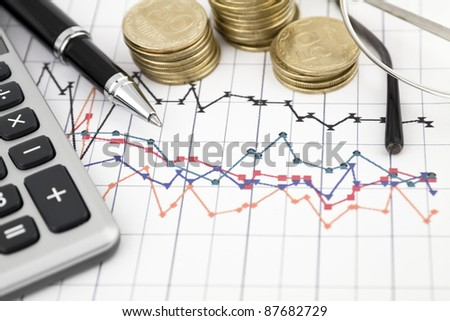 Business concept with notebook, glasses, pen and calculator
