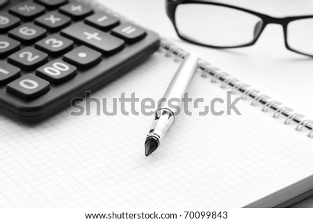 Business concept with notepad and calculator - stock photo