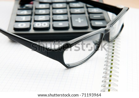 Business concept with notepad and calculator