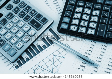 Business concept with two calculators on documents