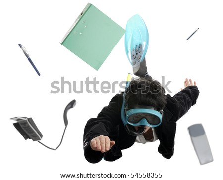 business concept: woman diving between office items