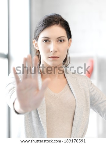 business concept - young woman making stop gesture - stock photo