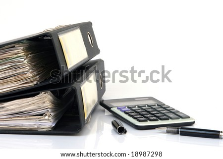 business concepts clip folders full of documents and calculator isolated with copyspace - stock photo