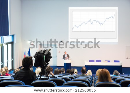 Business Conference and Presentation. Audience at the conference hall. Television broadcasted press conference. - stock photo